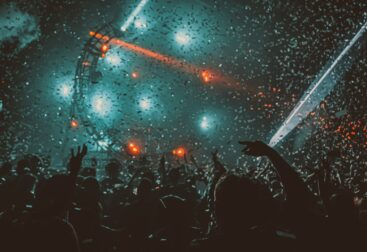 crowd partying with red stage lights